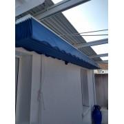 Pergola toile rétractable micro-perforée entre 2 murs sur cable
